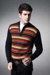 Portrait of a handsome young male in sweater