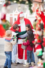 Children Embracing Santa Claus