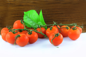 tomato on wood tray on white