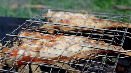 barbecue .Rock Fish on the grill with flames