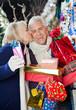 Woman Kissing Man At Christmas Store