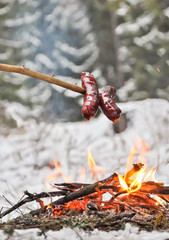 Sausages and winter campfire