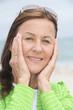Joyful happy attractive mature woman