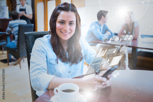 Smiling young woman studying on futuristic smartphone