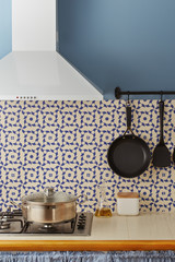 Boiling pot in pretty vintage tiled kitchen