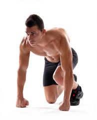 Corredor atleta en posición de partida.Deportista.