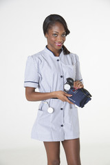 Nurse holding blood pressure monitor