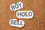 Buy Hold or Sell on a cork notice board