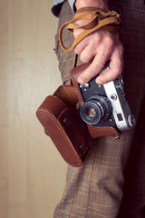 Man hand holding a retro camera
