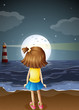 A small girl watching the fullmoon at the beach