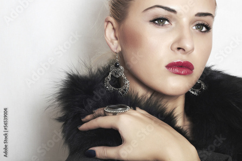 beautiful blond woman in fur.Jewelry and Beauty.red lips