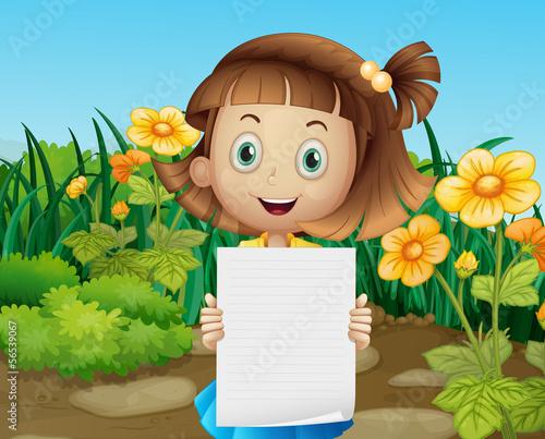 A cute little girl holding an empty sheet of paper