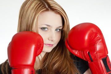 portrait of woman with boxing gloves