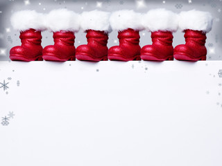 Voucher for christmas with many Santa Claus boots