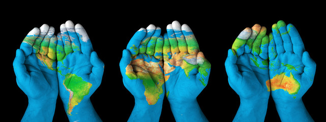 Map painted on hands.Concept of having the world in our hands