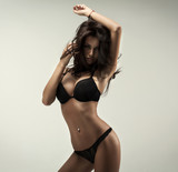 Beautiful brunette beauty in black underwear