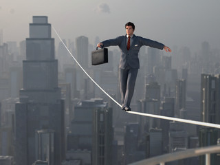 Businessman walking on Tightrope