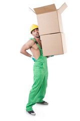 Man in green coveralls with boxes