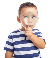 kid holding a magnifying glass on a white background