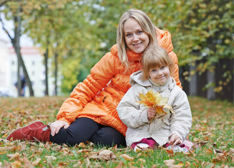 Happy mother and daughter in autumn