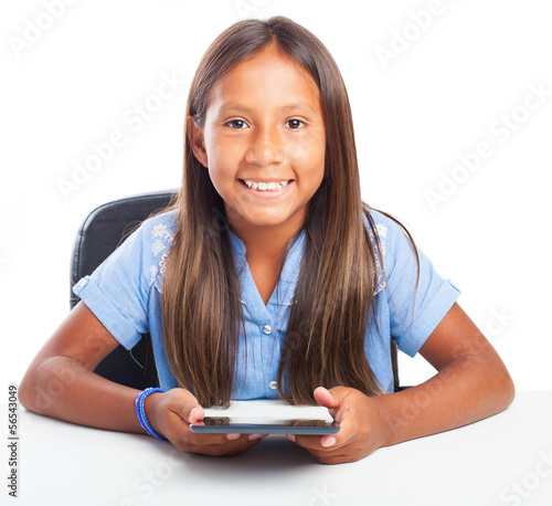 smiling girl showing the tablet on a white background