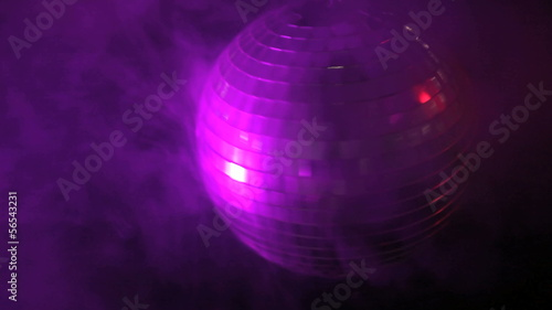 Disco ball in smoky purple light