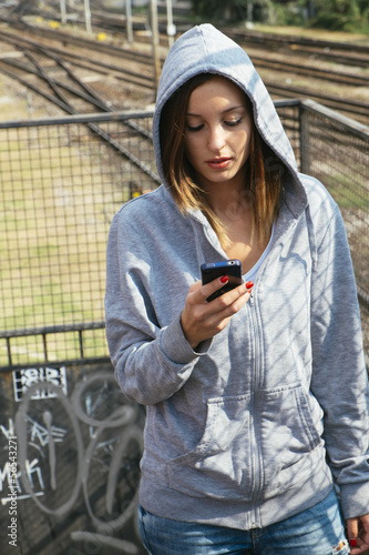 girl using her cell phone portrait