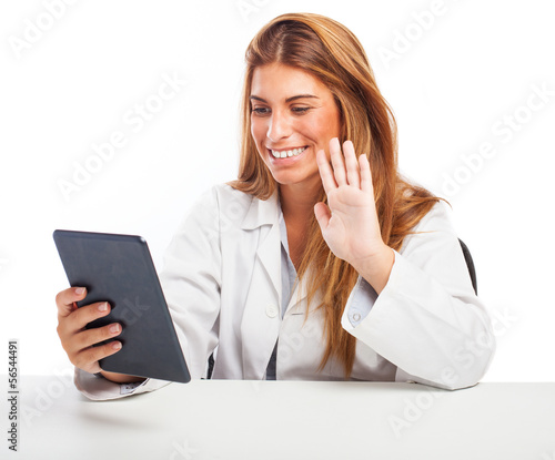 woman doctor having a conference by tablet