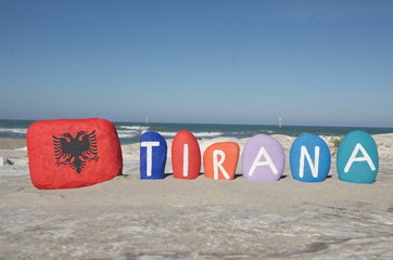 Tirana, souvenir on colourful stones on the sand