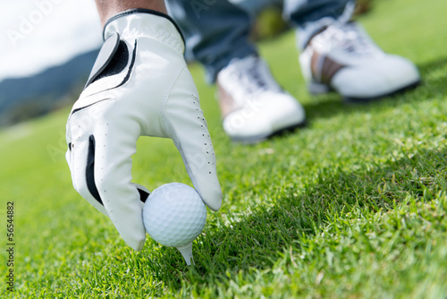 Man placing golf ball