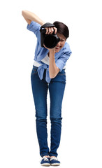 Woman-photographer takes shots, isolated on a white