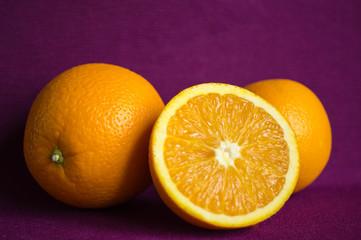 Oranges on a violet background