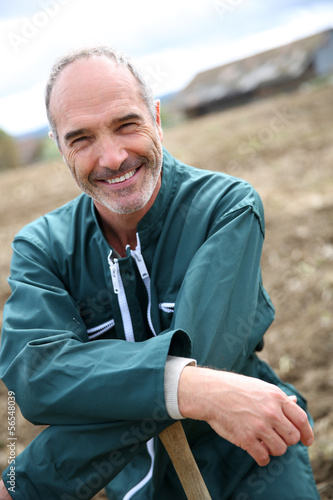 Portrait of cheerful farmer in agricultural field