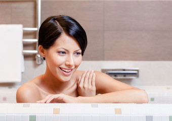 Beautiful pretty woman relaxes in bath