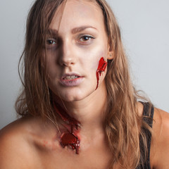 Wounded woman. Realistic bloody wound
