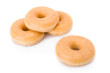 Four doughnuts or donuts piled isolated on white.