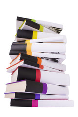 Pile of colorful books isolated on white.