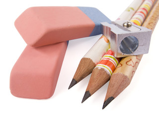 Pencil, sharpener and eraser on white background.