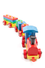Toy wooden train isolated on white