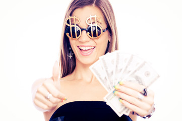 Young woman showing ok and holding Dollars