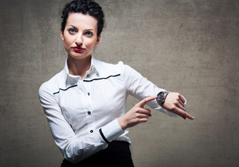Business woman showing the time on her wrist watch.