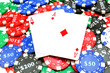 background of poker chips and two aces
