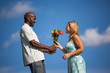Young Man Giving Flowers to a beautiful woman
