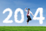 Businessman jumps with clouds of 2014