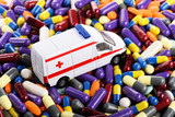 Ambulance car toy on the pills