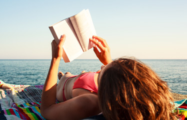 Reading book in the beach