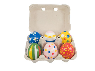 Real hand painted Easter eggs in egg box