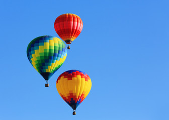 hot air balloons against blue sky