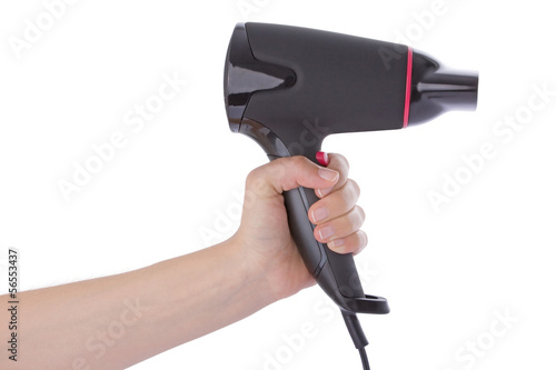 Hand holding a hairdryer isolated on a white background.