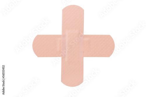 Cross made with bandaids isolated on white.
